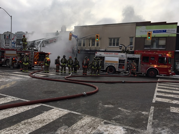 Fire crews battle a four-alarm blaze at a two-story building on Danforth Avenue on Jan. 22, 2019.