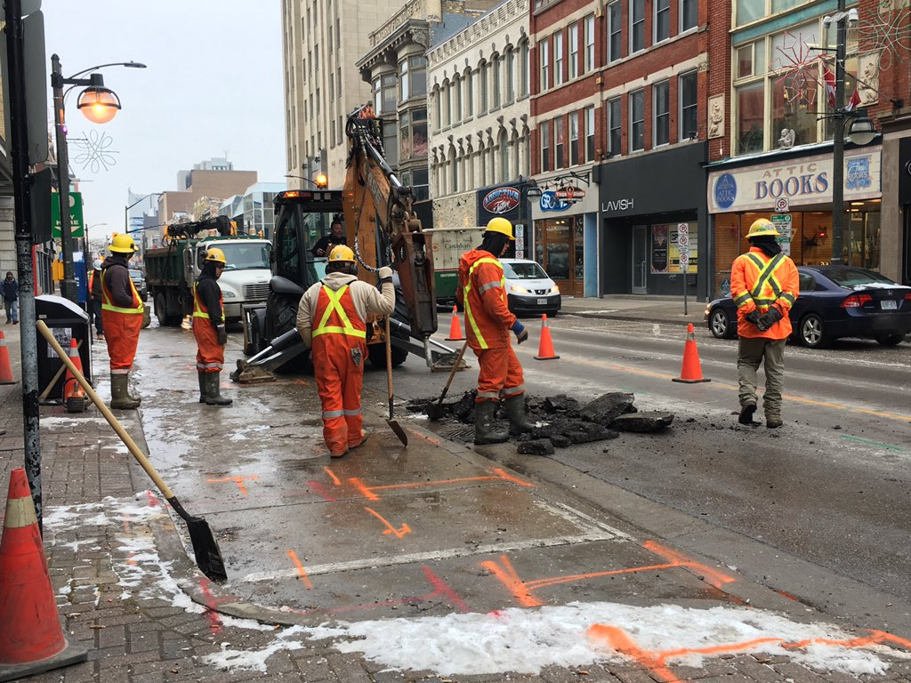 Maintenance crews begin to dig up the pavement of Dundas Street's eastbound lane, to repair a broken watermain on January 15, 2019.