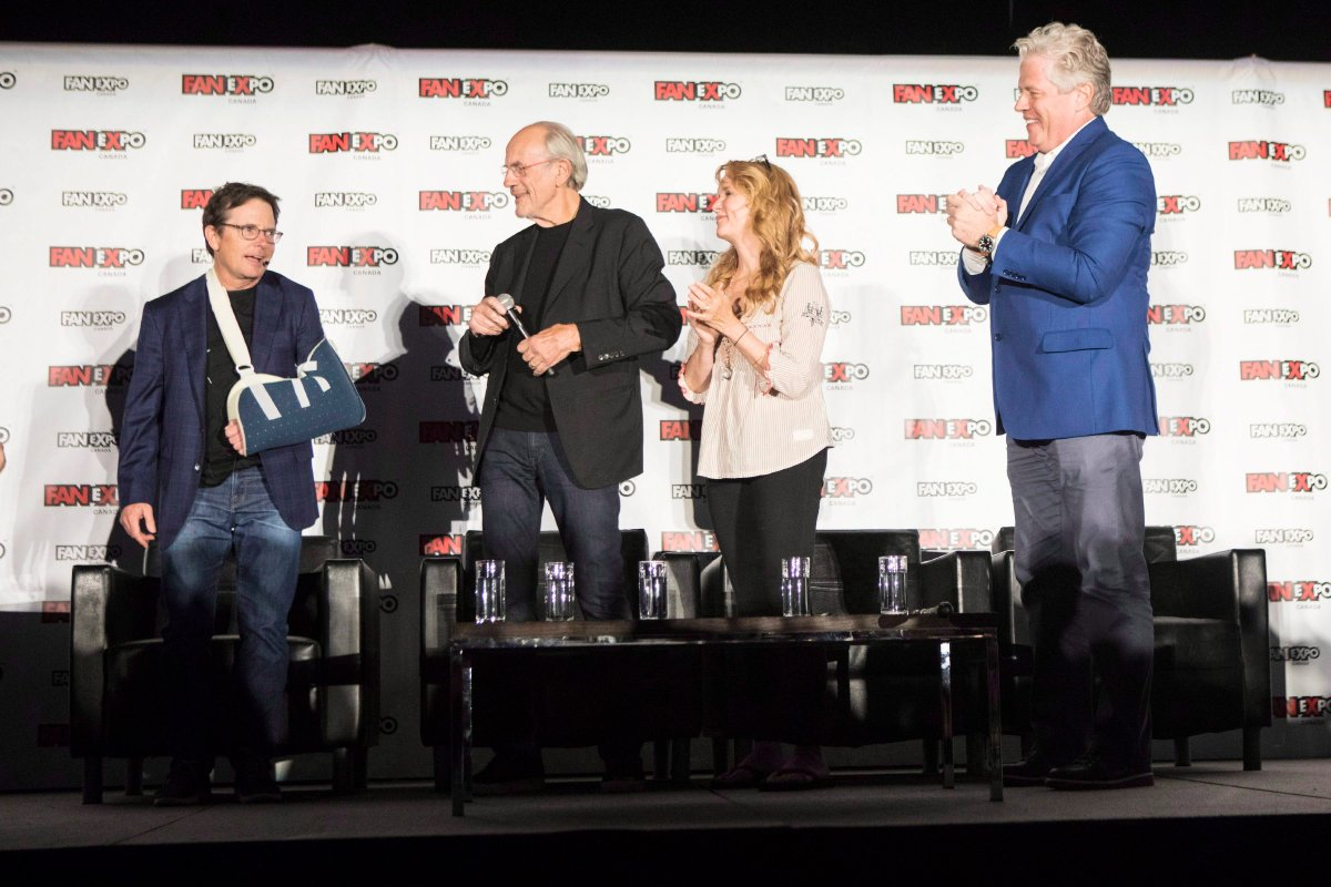 Actor Michael J.Fox (left) is welcomed on stage by fellow cast members Christopher Lloyd (centre left) Lea Thompson (centre right) and Tom Wilson as they attend a panel discussion for the 'Back to the Future' movie franchise at Fan Expo Canada in Toronto on Friday August 31 , 2018.