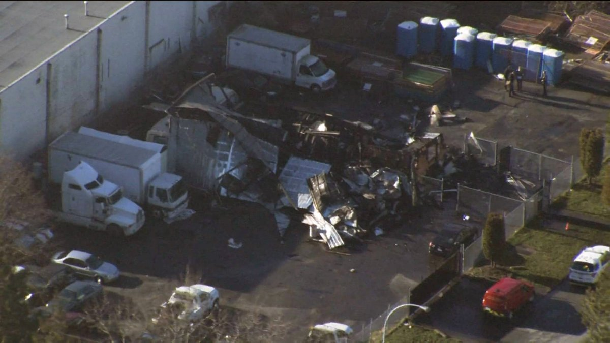 An aerial image shows the completely destroyed structure of H&R Towing.