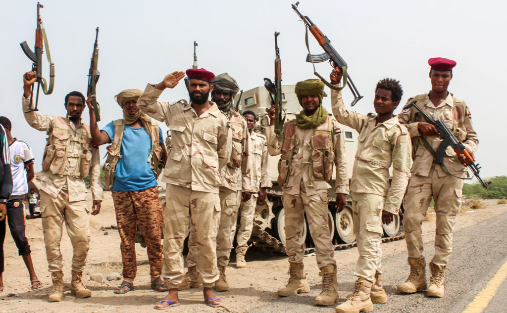 Sudanese soldiers fighting alongside Yemen's Saudi-backed pro-government forces salute beside a road near Al-Jah, Yemen, June 22, 2018.