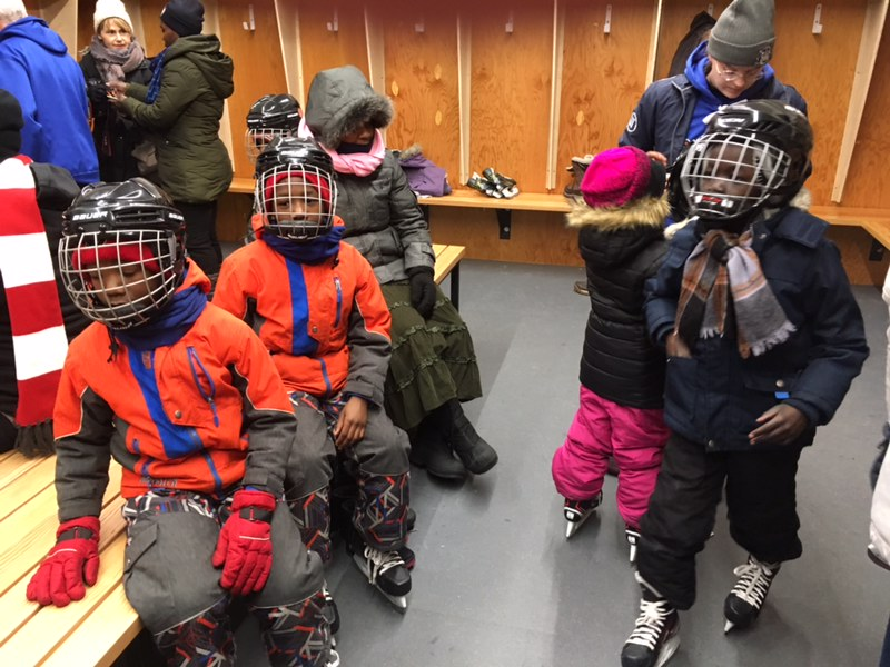 Kids ready to go skating for the first time.