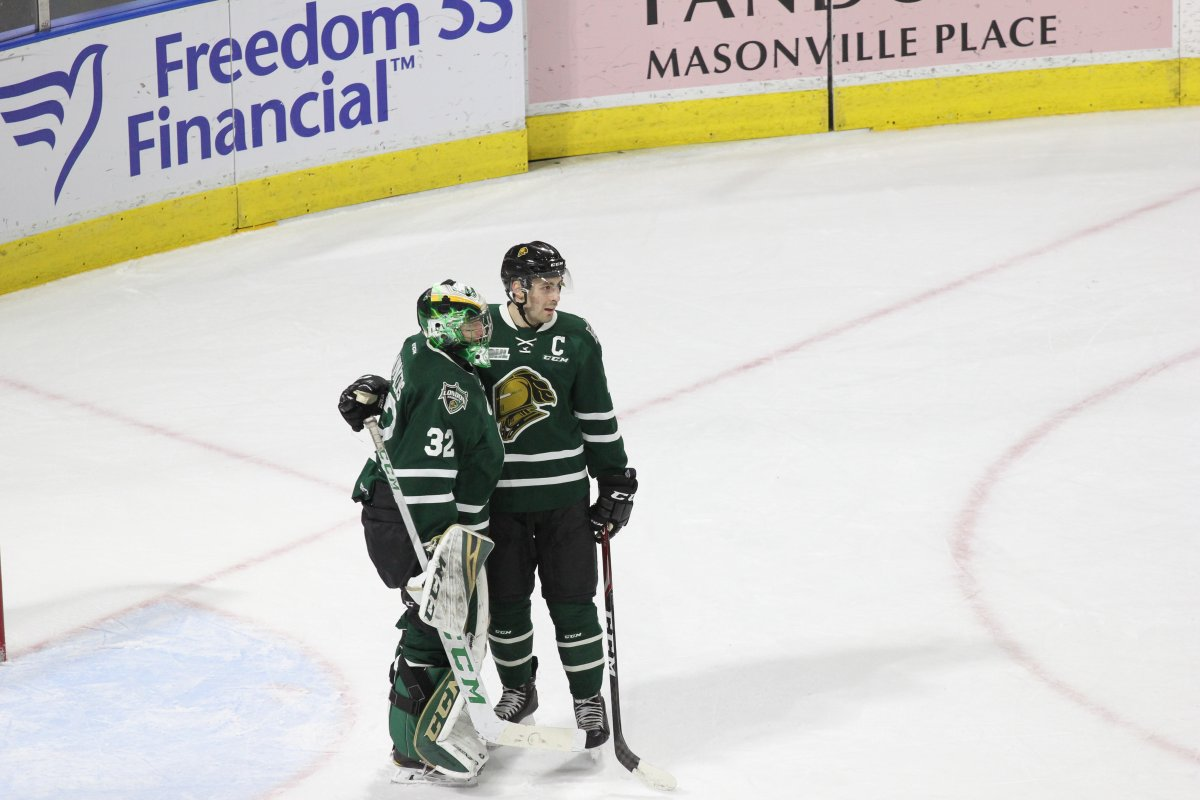 London, Ont. - Knights captain Evan Bouchard congratulates London goaltender Joseph Raaymakers on a shutout against Windsor in a 7-0 London victory at Budweiser Gardens on January 25, 2019.