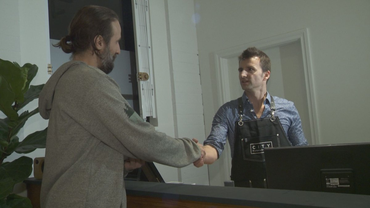Krystian Wetulani with City Cannabis Co. makes his first ever legal sale after getting provincial and municipal licences to open.