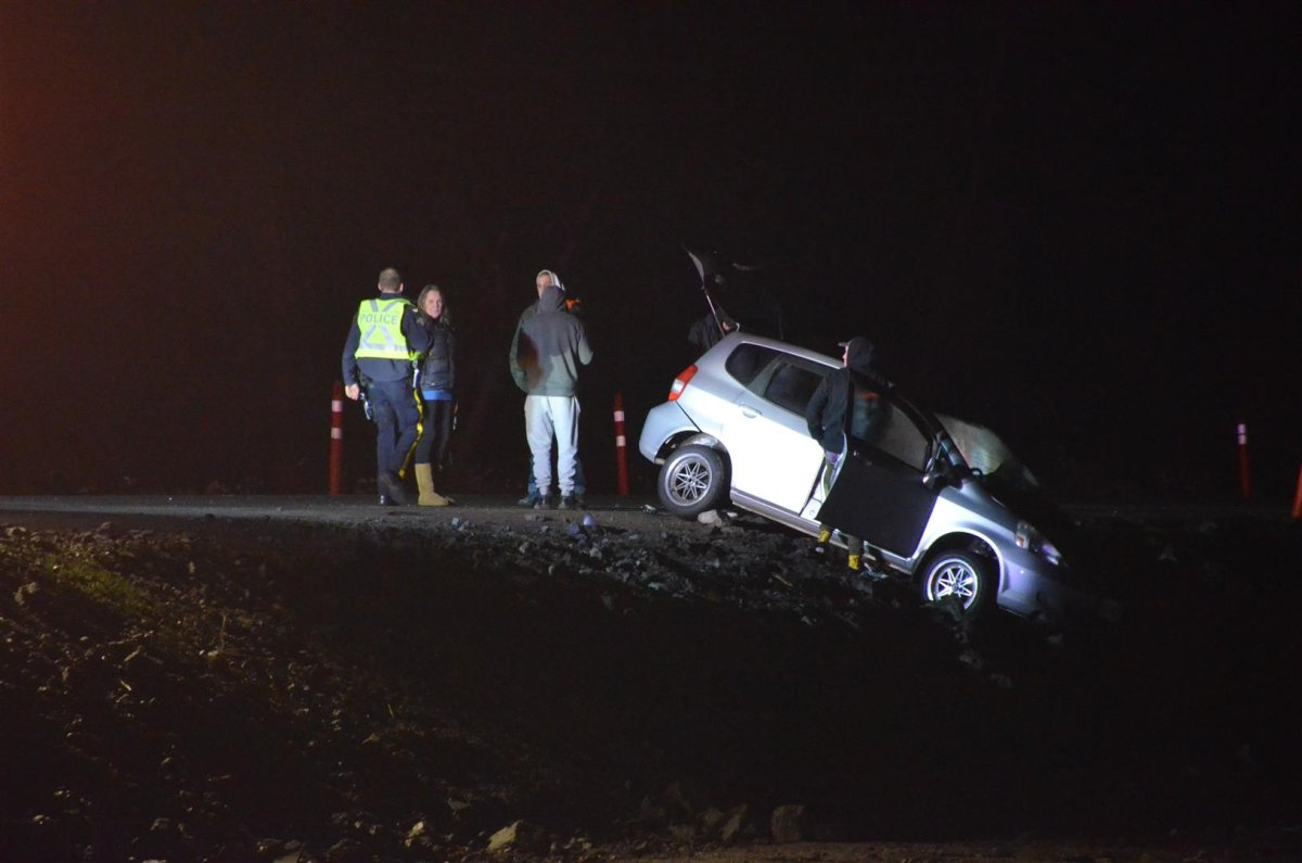 Two of the three vehicles had collided head-on and one flipped onto its side, officials said.