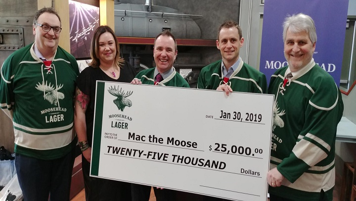 """The City of Moose Jaw and Tourism Moose Jaw accept a $25,000 donation from Canada's Moosehead Breweries to help make Mac The Moose, once again, the """"World's Tallest Moose""""."""