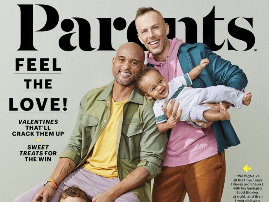 Fitness trainer Shaun T and husband Scott Blokker on the cover of Parents magazine with their two sons.