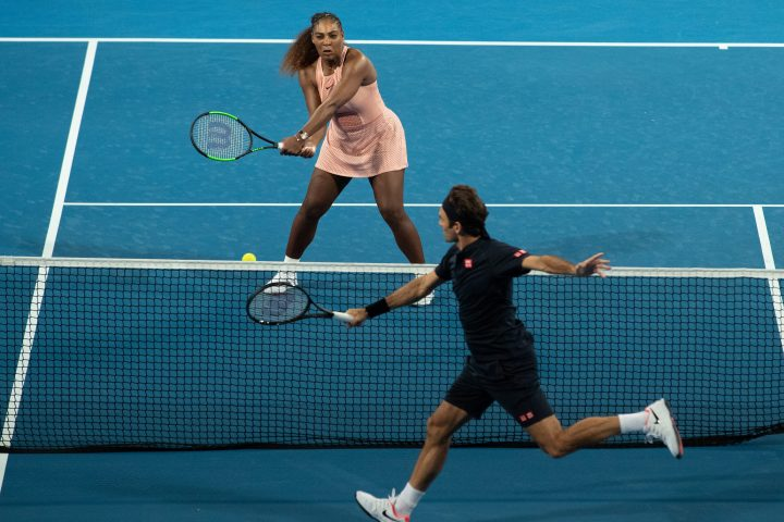 Serena Williams of the USA and Roger Federer of Switzerland in action during the mixed doubles match between Roger Federer and Belinda Bencic of Switzerland and Frances Tiafoe and Serena Williams of the USA on day 4 of the Hopman Cup tennis tournament at RAC Arena in Perth, Western Australia, Australia, 01 January 2019.
