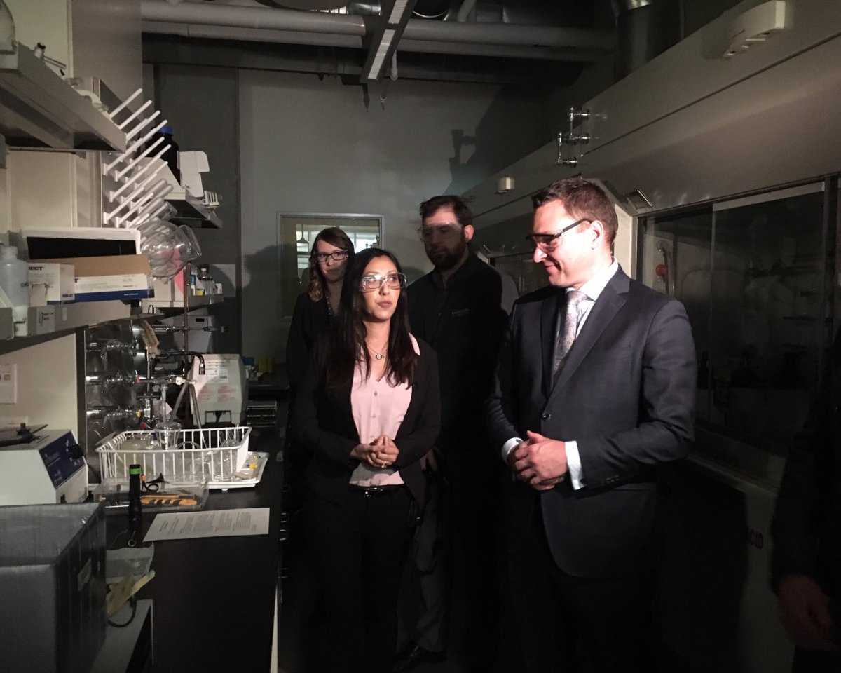 Minister Deron Bilous learns about how one company is trying to turn windows into solar panels.