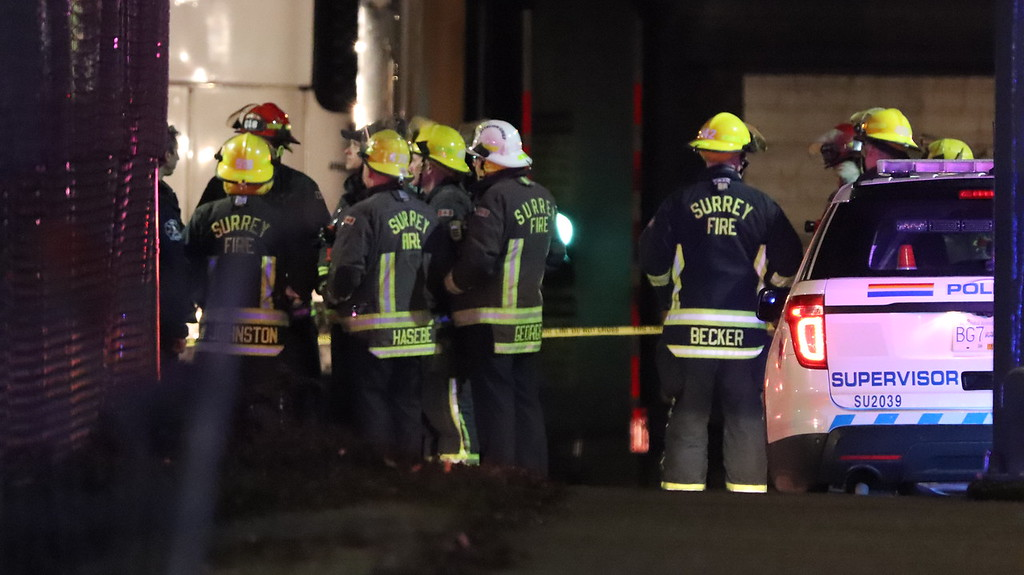 Firefighters attend the scene of an ammonia leak in Surrey early Saturday morning.