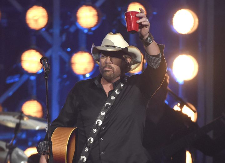 """Toby Keith raises a red cup after performing """"Should've Been a Cowboy"""" at the 53rd annual Academy of Country Music Awards at the MGM Grand Garden Arena on Sunday, April 15, 2018, in Las Vegas."""