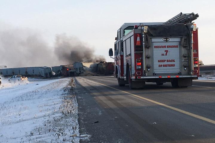 Freight cars block Highway 11 north of Saskatoon after a train derailment on Tuesday, Jan. 22, 2019.