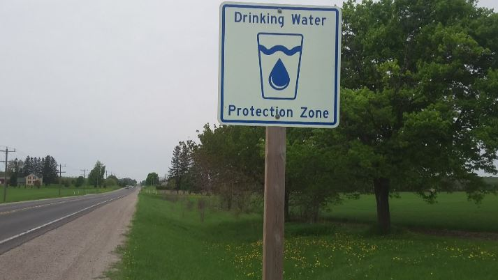 """A sign in Walkerton that reads """"Drinking water protection zone""""."""