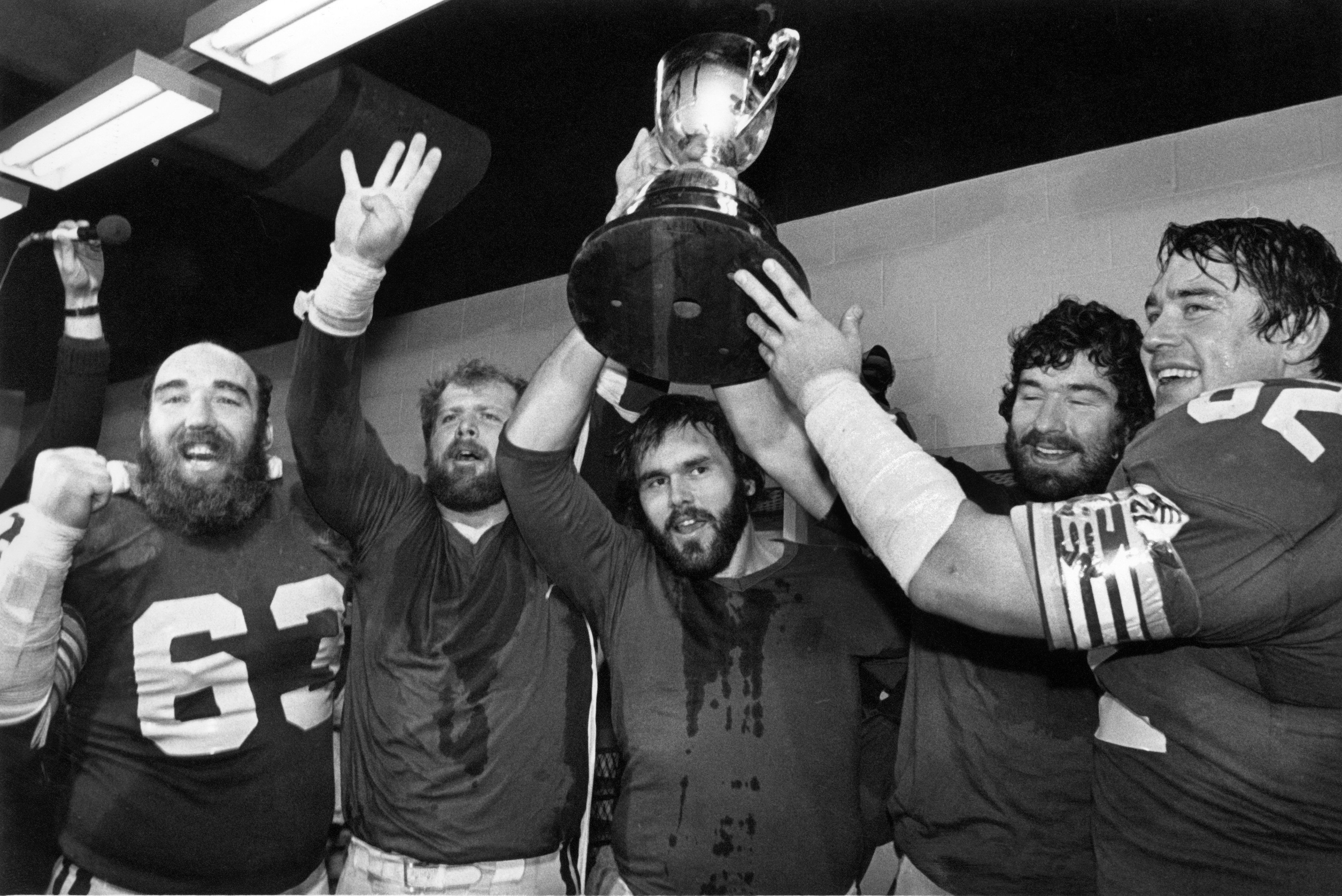Edmonton Eskimos Hector Pothier, Eric Upton, Ted Milian, Leo Blanchard and Bill Stevenson celebrate their fourth Grey Cup in a row in Montreal, QC November 22, 1981.