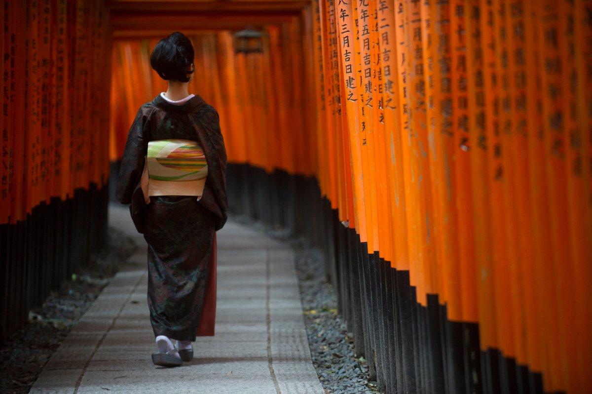 A Japanese woman clad in kimono walks through a series of Shinto torii gates at Fushimi Inari Shrine in Kyoto, Japan, on Oct. 24, 2017.