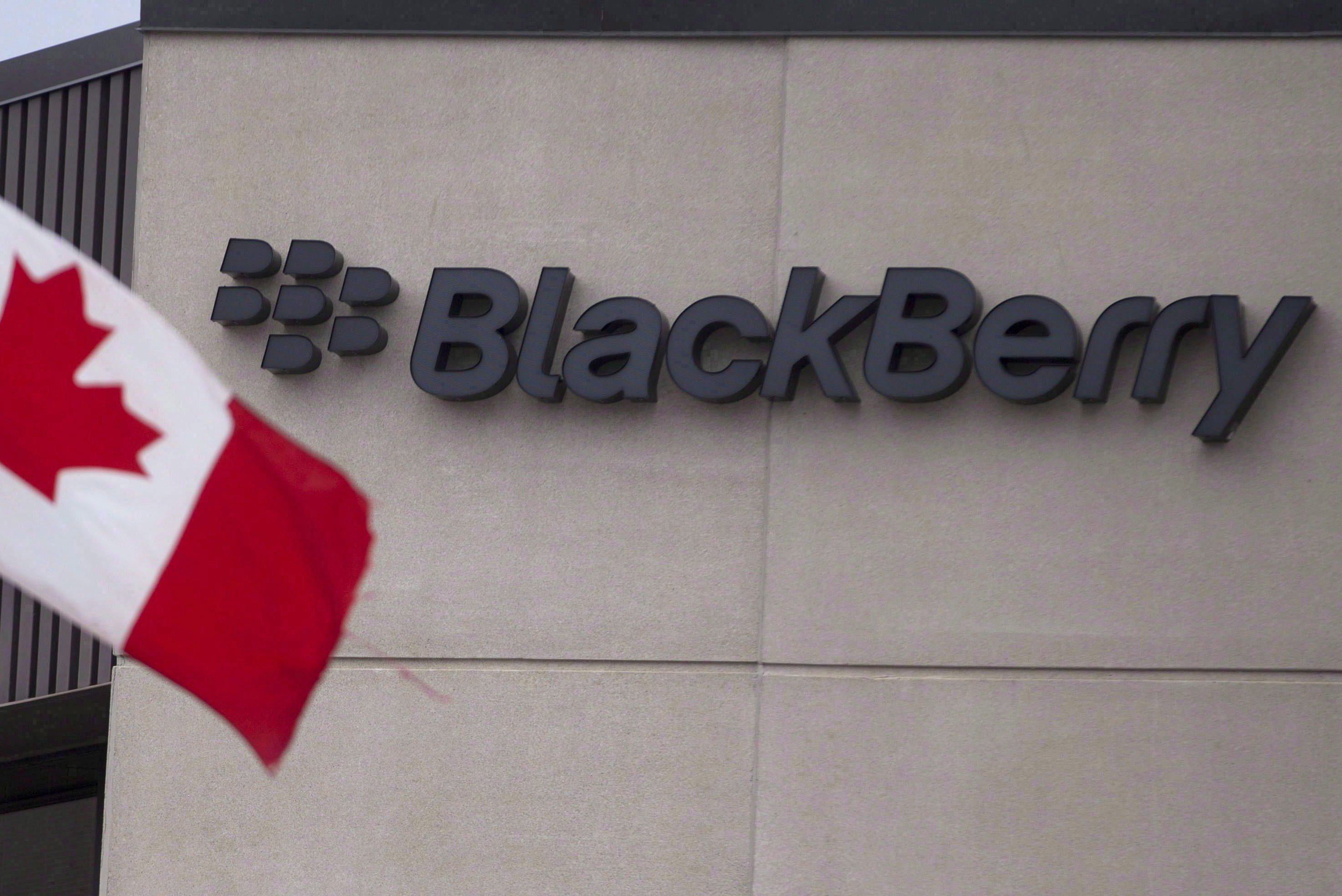 A Canadian flag flies at BlackBerry's headquarters in Waterloo, Ont., Tuesday, July 9, 2013.