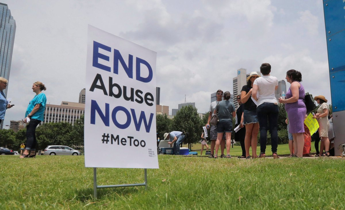 A small group of protesters fighting various forms of abuse within the church engage passersby outside at the Southern Baptist Convention meeting in Dallas, Texas, Tuesday, June 12, 2018.
