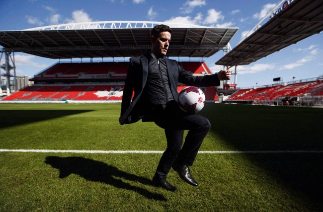 Canada men's national soccer team newly-announced coach John Herdman poses for a picture at BMO Field in Toronto on February 26, 2018.
