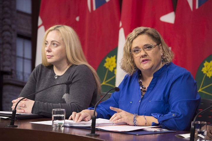 Laura Kirby-McIntosh (right), president of the Ontario Autism Coalition, speaks as autism parent Maria Galito listens in at a news conference at the Ontario Legislature in Toronto on Monday, November 12, 2018. THE CANADIAN PRESS/Frank Gunn.