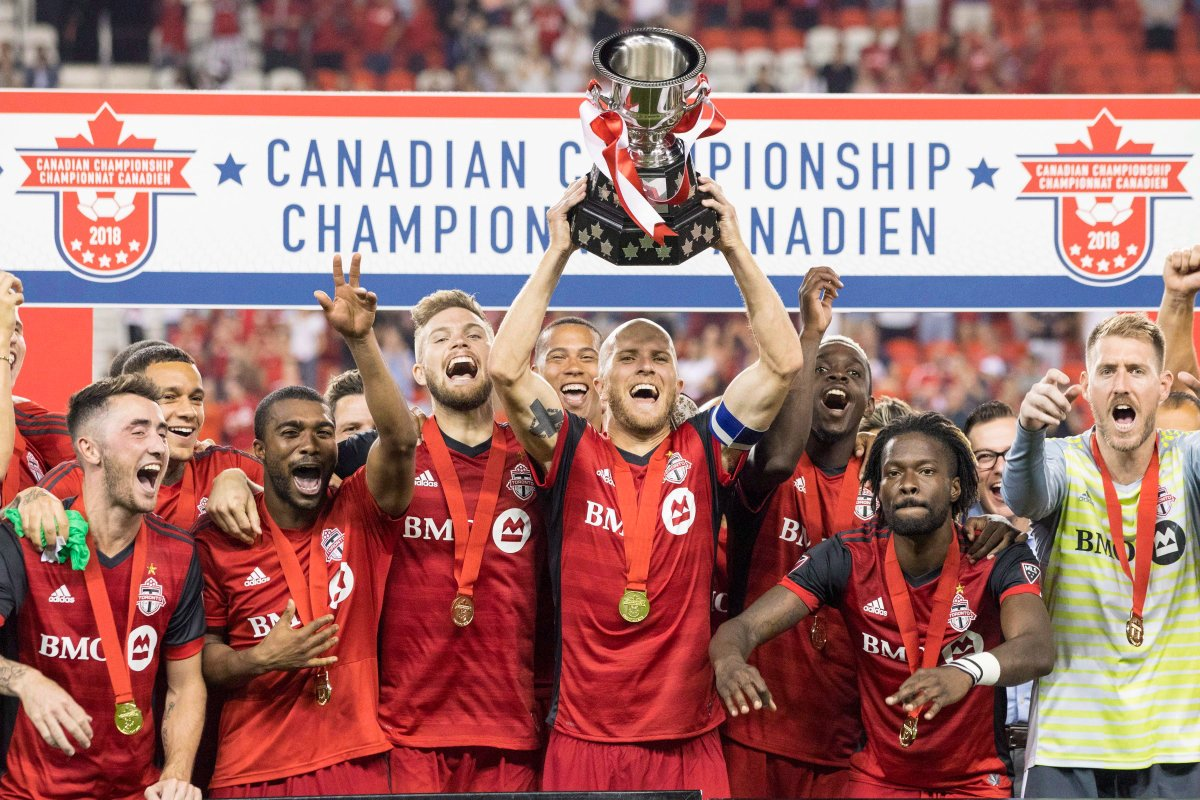 Toronto FC captain Michael Bradley lifts the Voyageurs Cup after beating Vancouver Whitecaps 5-2 to win the Canadian Championship Final, in Toronto on Wednesday, August 15, 2018.