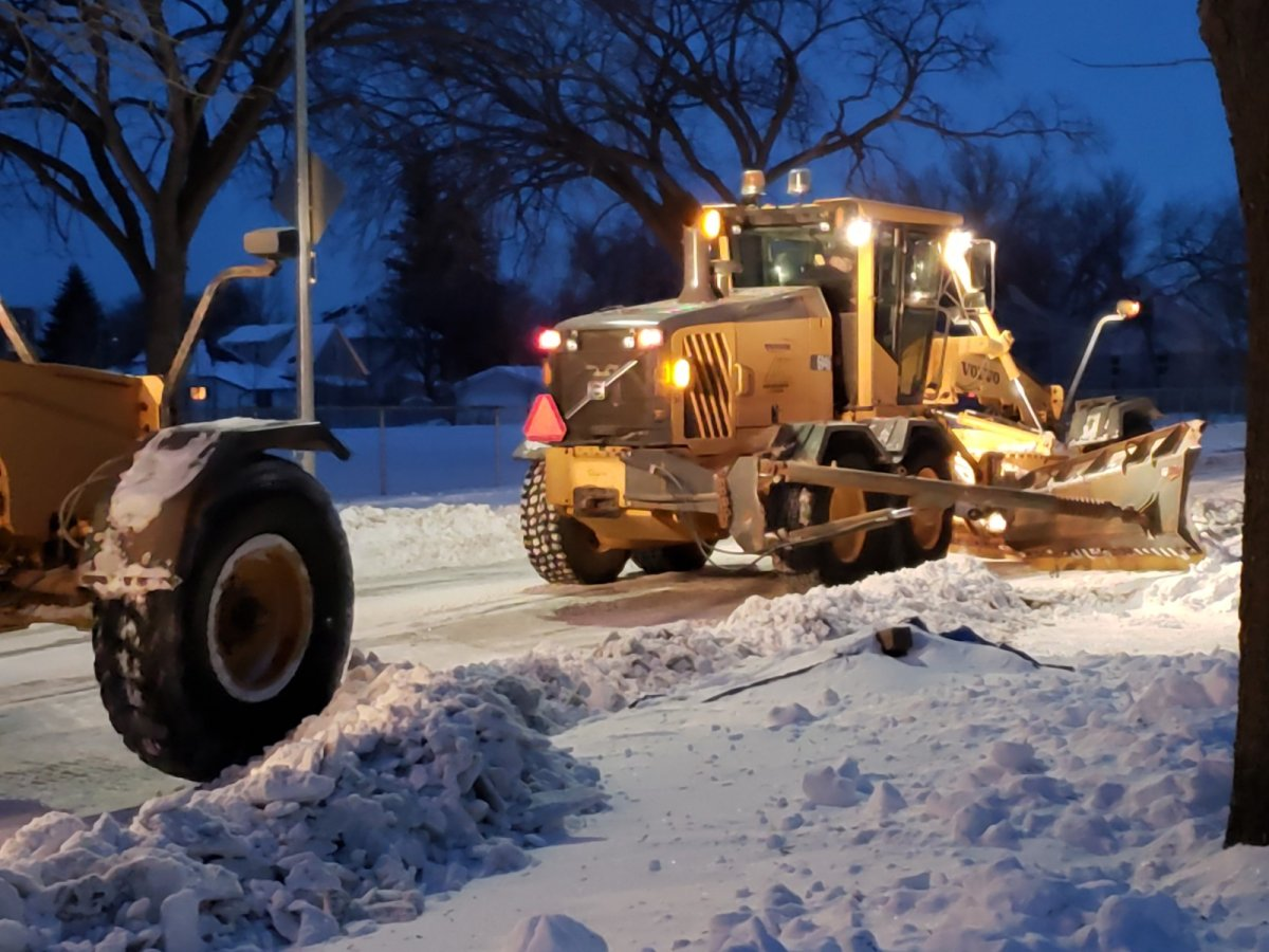 Snow clearing on a residential street in Winnipeg.