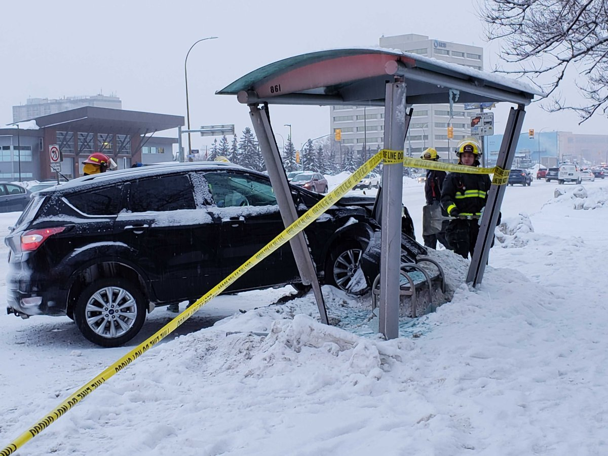 A vehicle is seen crashed into a bus shelter on Portage Ave.