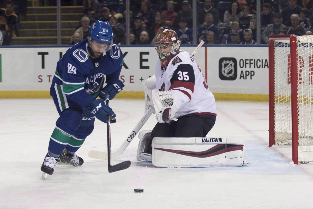 Vancouver Canucks forward Sam Gagner (89) takes shot on net as Arizona Coyotes goaltender Darcy Kuemper (35) makes the save during first period preseason action in Kelowna , B.C. on September 29, 2018. Sam Gagner felt like he was playing well. The veteran forward says the Vancouver Canucks agreed. That's why his demotion to the American Hockey League -- a second this season -- came as a shock last week. THE CANADIAN PRESS/Jeff Bassett.
