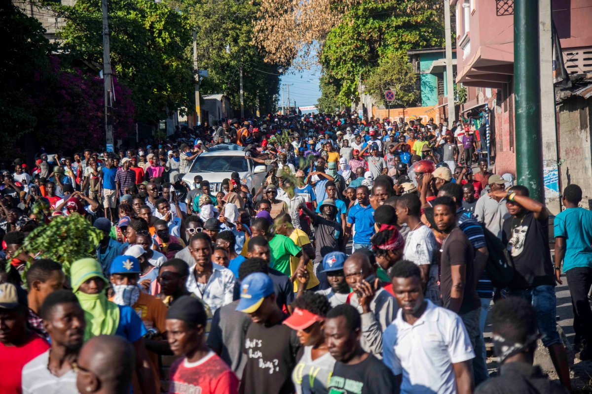 People march during a protest in Port-au-Prince, Haiti, on Feb. 13, 2019. The political crisis in Haiti is aggravated by a week of violent protests calling for the resignation of President Jovenel Moise, which has left at least nine dead.