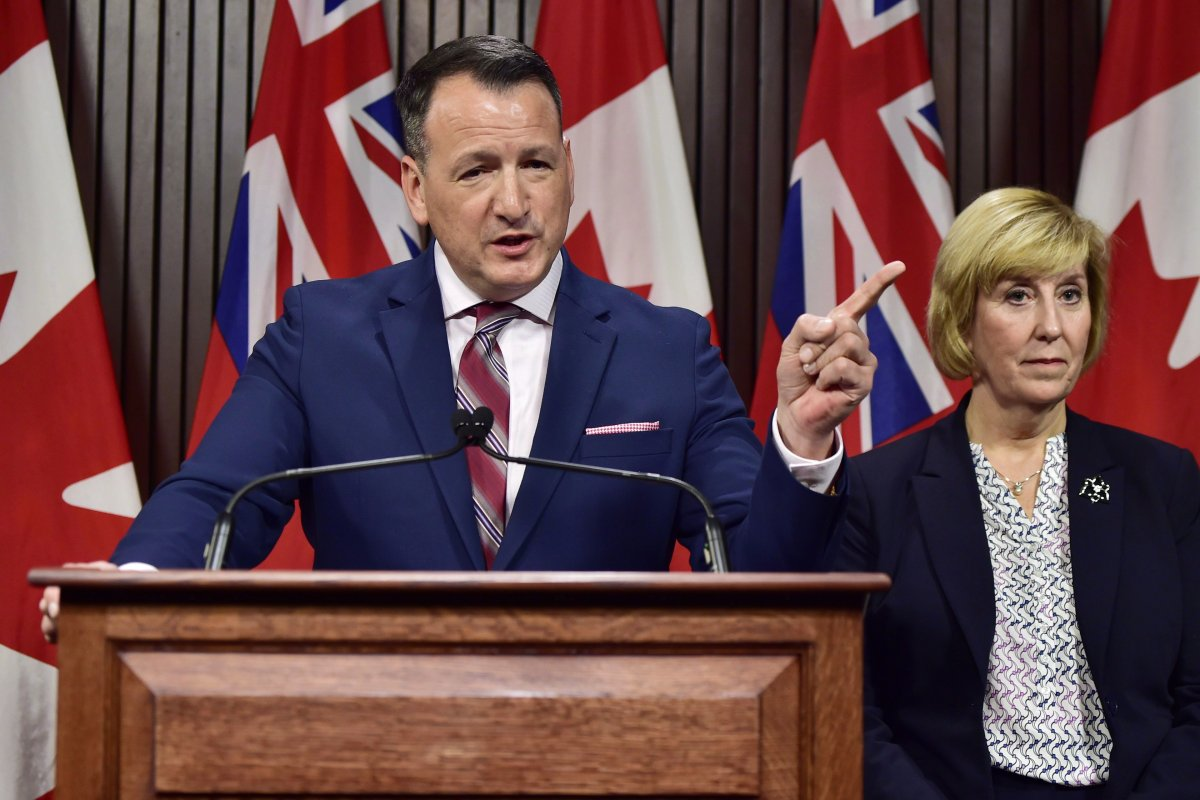 Spokesperson to the report says Energy Minister Greg Rickford, seen on the left, is considering the panel's recommendations.