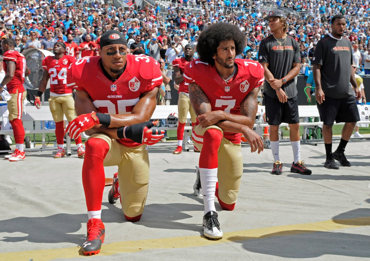 FILE - In this Sept. 18, 2016, file photo, San Francisco 49ers' Colin Kaepernick (7) and Eric Reid (35) kneel during the national anthem before an NFL football game against the Carolina Panthers, in Charlotte, N.C.