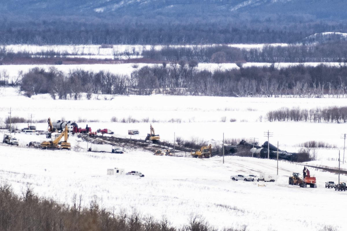 Excavators work at the site of a train derailment ten-kilometres south of St. Lazare, Man. on Saturday February 16, 2019. A train carrying oil has derailed and is leaking in western Manitoba. Canadian National Railway says in a statement that 37 cars carrying crude left the tracks early Saturday morning near St-Lazare, just east of the Saskatchewan-Manitoba boundary.