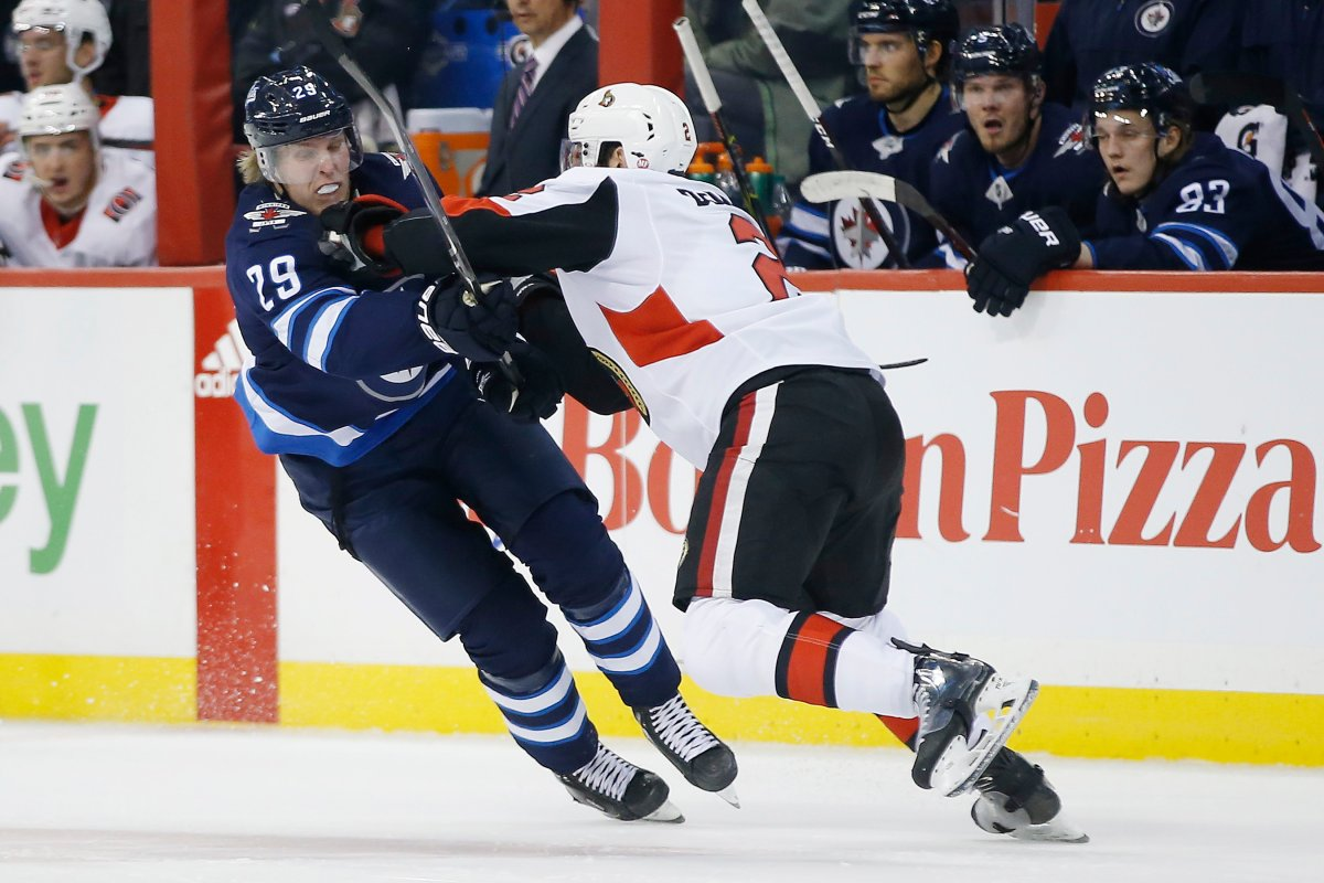 Winnipeg Jets' Patrik Laine (29) can't get past Ottawa Senators' Dylan DeMelo (2) during second period NHL action in Winnipeg on Saturday, Feb. 16, 2019.