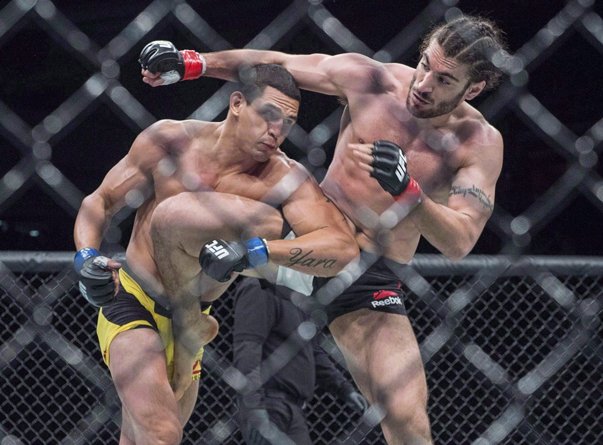 Elias Theodorou, right, of Mississauga, Ont., battles Cezar Ferreira, of Brazil, in middleweight UFC Fight Night action, in Halifax on Sunday, Feb. 19, 2017.
