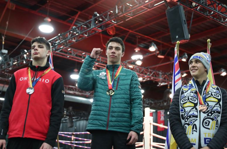 Boxer Isaiah Haya of Quispamsis, N.B., receives his gold medal at the 2019 Canada Games on Wednesday, Feb. 20, 2019.