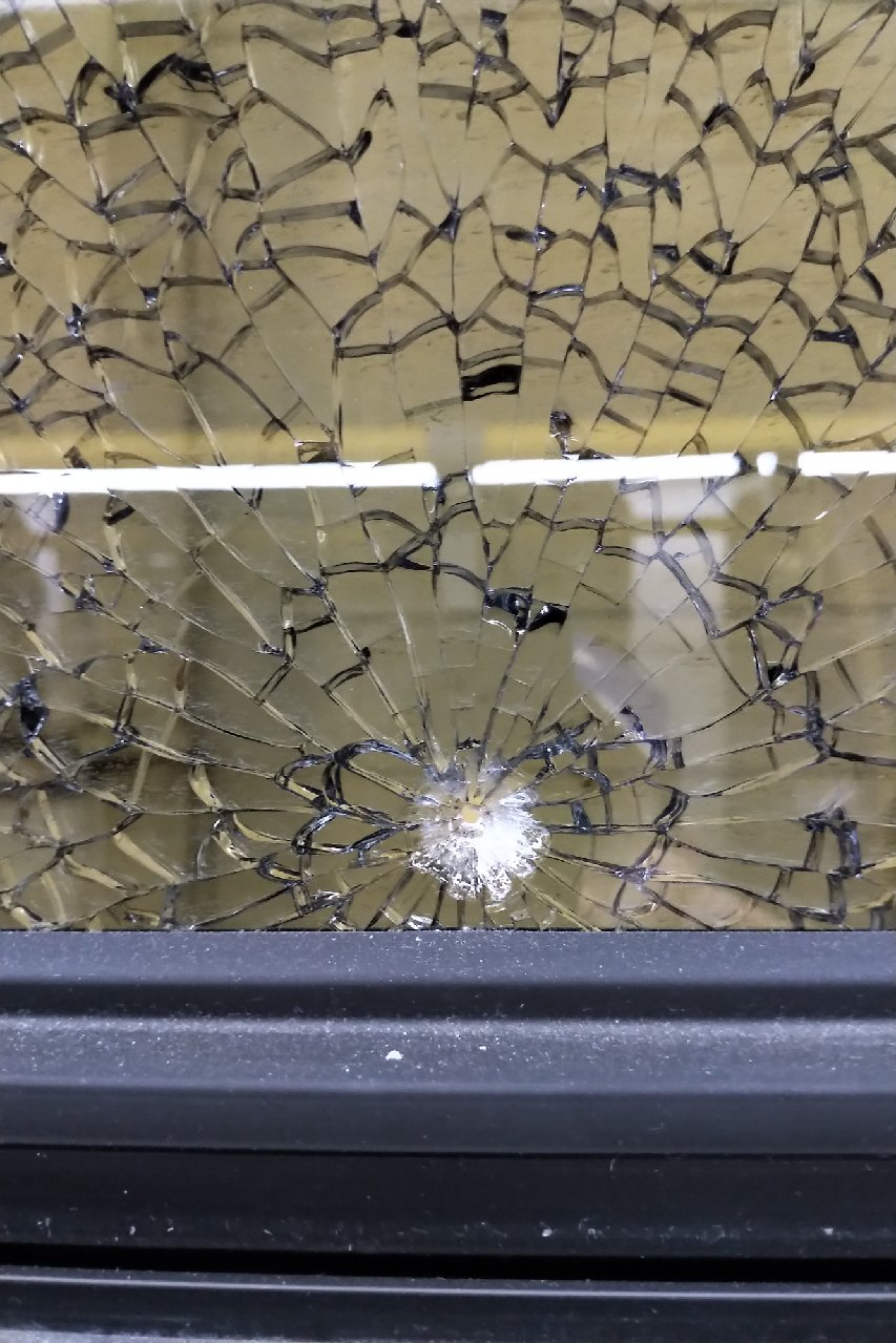 The City of Kingston provide this photo of the damage done to one of the three windows allegedly shot by a Kingston man over the weekend.