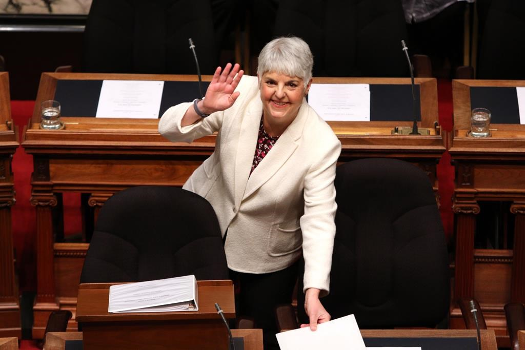 Finance Minister Carole James arrives to deliver the budget speech as she waves to people in the gallery at the legislature in Victoria, B.C., on Tuesday, February 19, 2018. THE CANADIAN PRESS/Chad Hipolito.