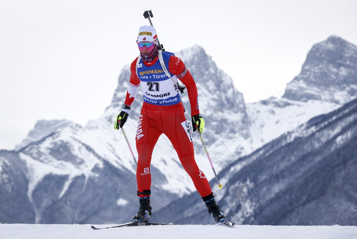 Arctic temperatures in Alberta have forced organizers to cancel competition at the biathlon World Cup. Canada's Rosanna Crawford skis during World Cup biathlon women's short 12.5 km event in Canmore, Alta., Thursday, Feb. 7, 2019.