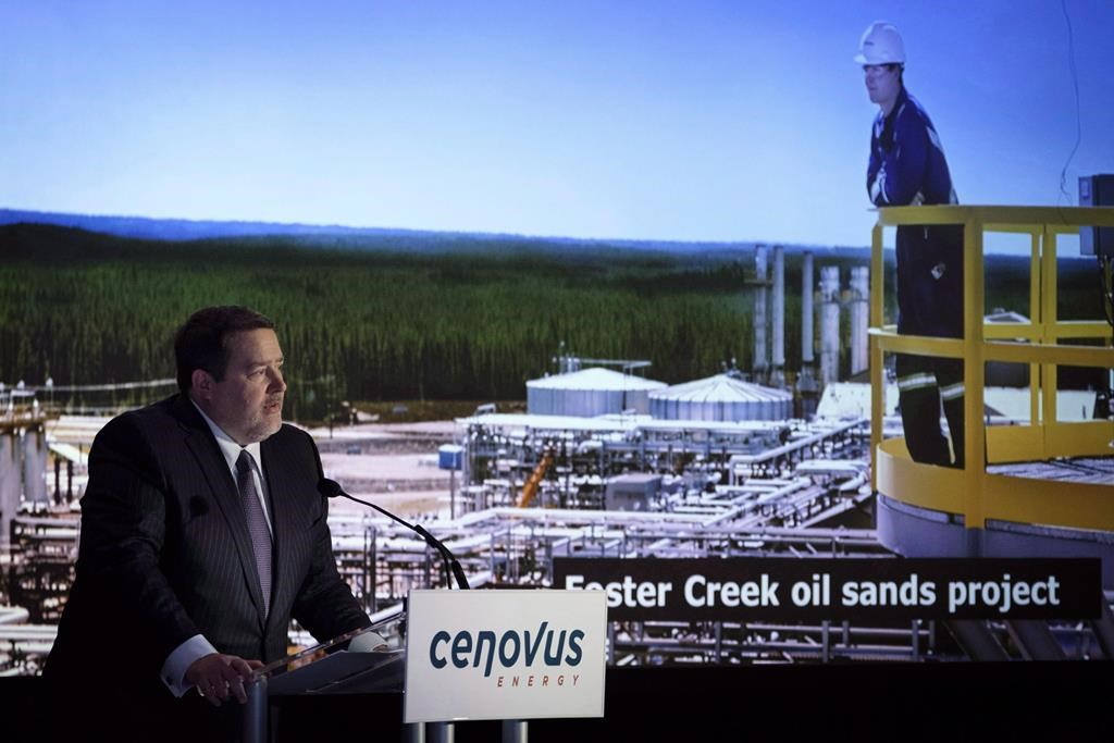 Cenovus president and CEO Alex Pourbaix, left, addresses the company's annual meeting in Calgary, Wednesday, April 25, 2018.