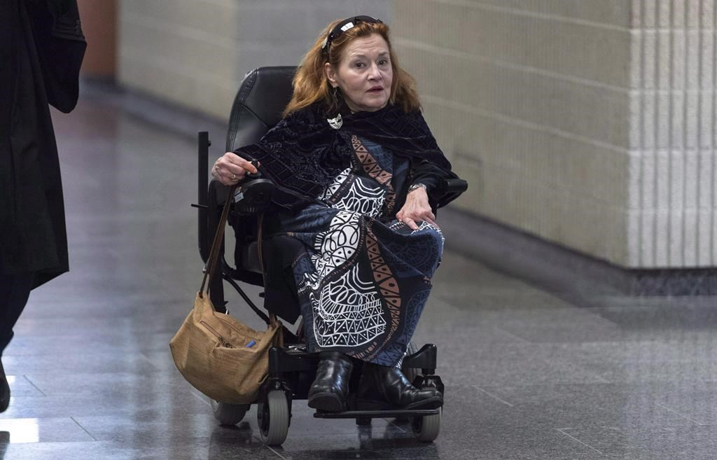 Nicole Gladu, who is incurably ill, arrives at the courthouse in Montreal on Monday, January 7, 2019, for the beginning of a trial challenging the provincial and federal laws on medically assisted death on the grounds they are too restrictive.