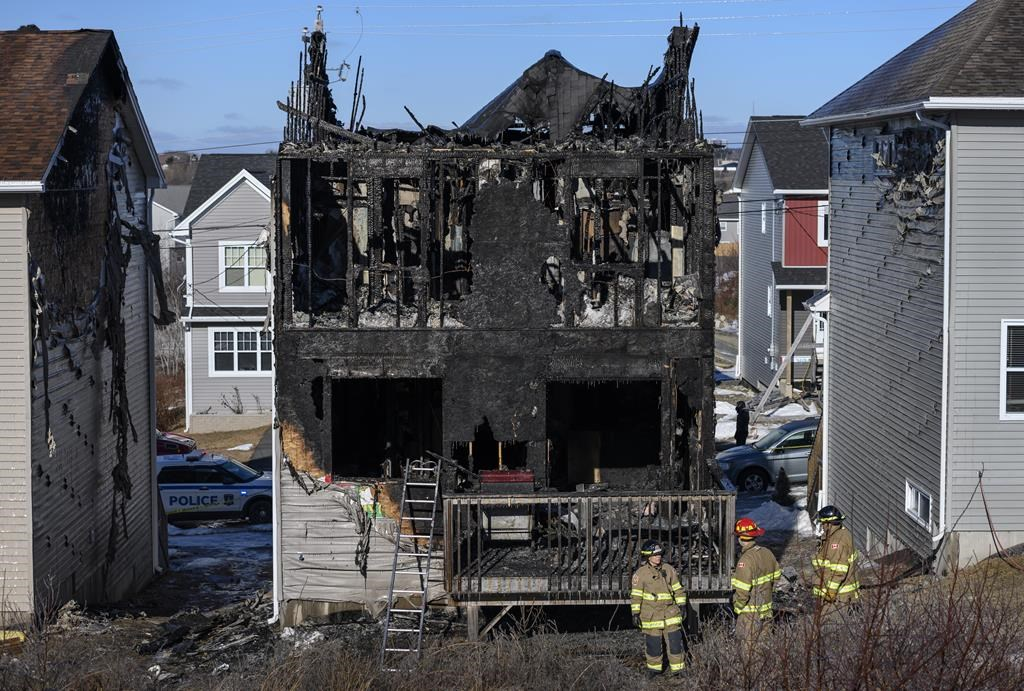 Firefighters investigate following a house fire in the Spryfield community in Halifax on Tuesday, February 19, 2019. Experts say the deaths of the seven Barho children in a ferocious Halifax house fire last week could lead to new fire safety measures and changes to the country's building code.