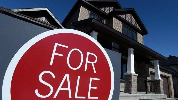A sign advertises a new home for sale in Carleton Place, Ont. April home sales posted the first year-over-year increase since Dec. 2017, the Canadian Real Estate Association said in a report release on May 15, 2019.