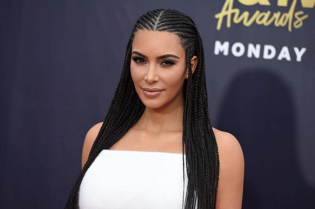 Kim Kardashian arrives at the MTV Movie and TV Awards at the Barker Hangar on Saturday, June 16, 2018, in Santa Monica, Calif.