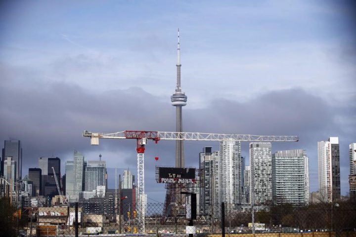 "Condominiums and the CN Tower are shown along the Toronto skyline on Tuesday, April 25, 2017. Real estate markets in Canada remain ""vulnerable"" despite an easing in overvaluation in cities like Toronto and Victoria in the third quarter, according to Canada Mortgage and Housing Corporation. THE CANADIAN PRESS/Cole Burston."