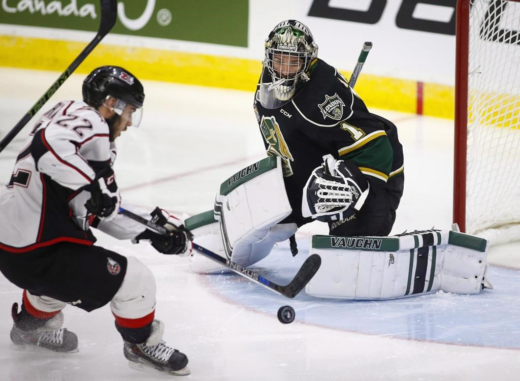 The Rouyn-Noranda Huskies' Peter Abbandonato, left, shoots on London Knights goalie Tyler Parsons during first-period CHL Memorial Cup hockey action in Red Deer, Alta., Tuesday, May 24, 2016.