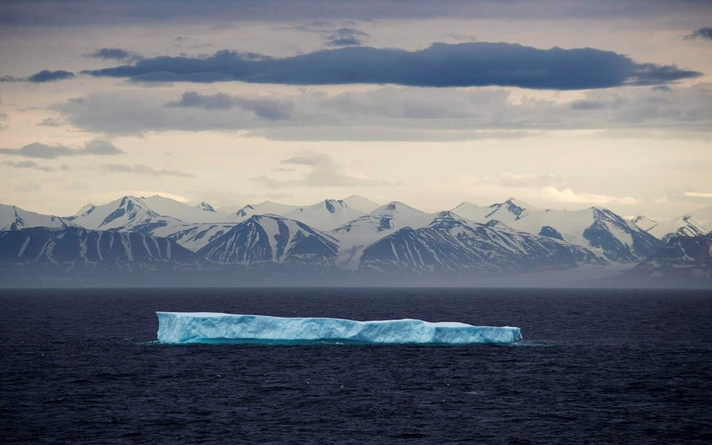An iceberg floats past Bylot Island in the Canadian Arctic Archipelago, Monday, July 24, 2017. It's not your usual theft target: Iceberg water.But police say 30,000 litres has been stolen from a warehouse in Port Union, N.L.