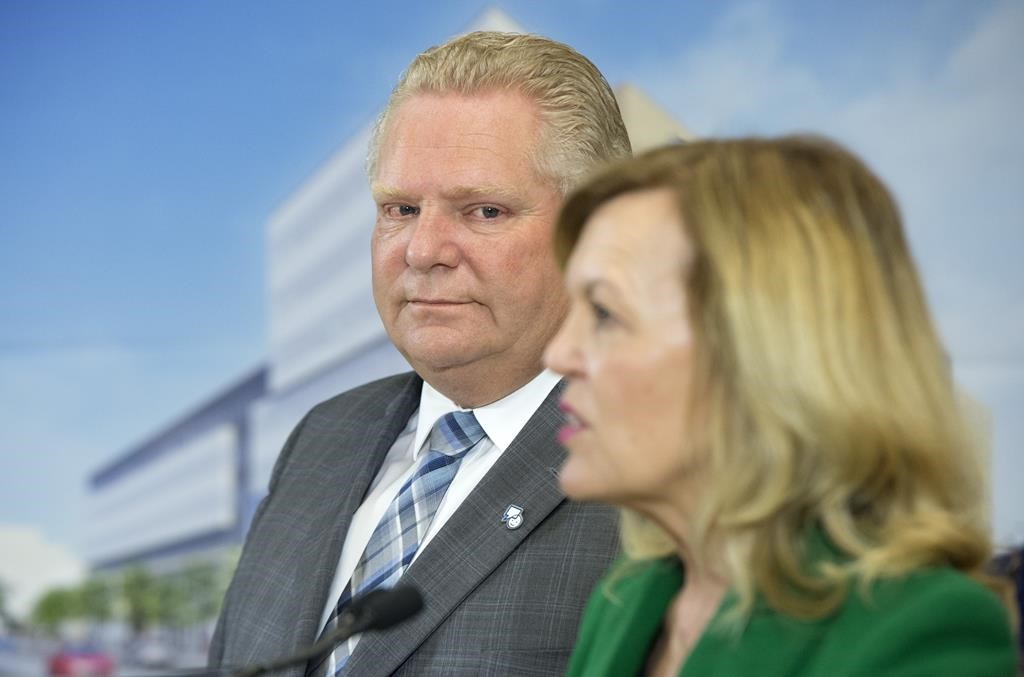Ontario Premier Doug Ford watches as Health Minister Christine Elliott speaks at an event at the Centre for Addiction and Mental Health in Toronto on Jan. 30, 2019.