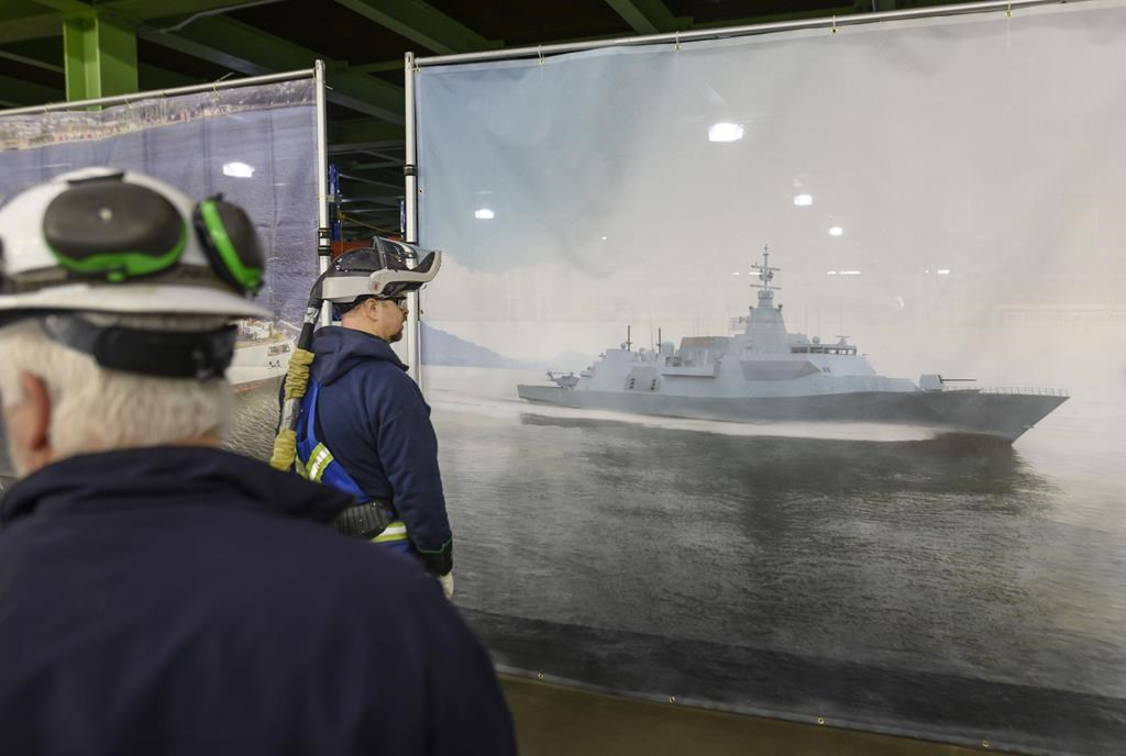 Shipbuilders look at Lockheed Martin Canada's design of 15 new Canadian Surface Combatants to be built at Irving Shipbuilding's Halifax shipyard in Halifax on February 8, 2019.