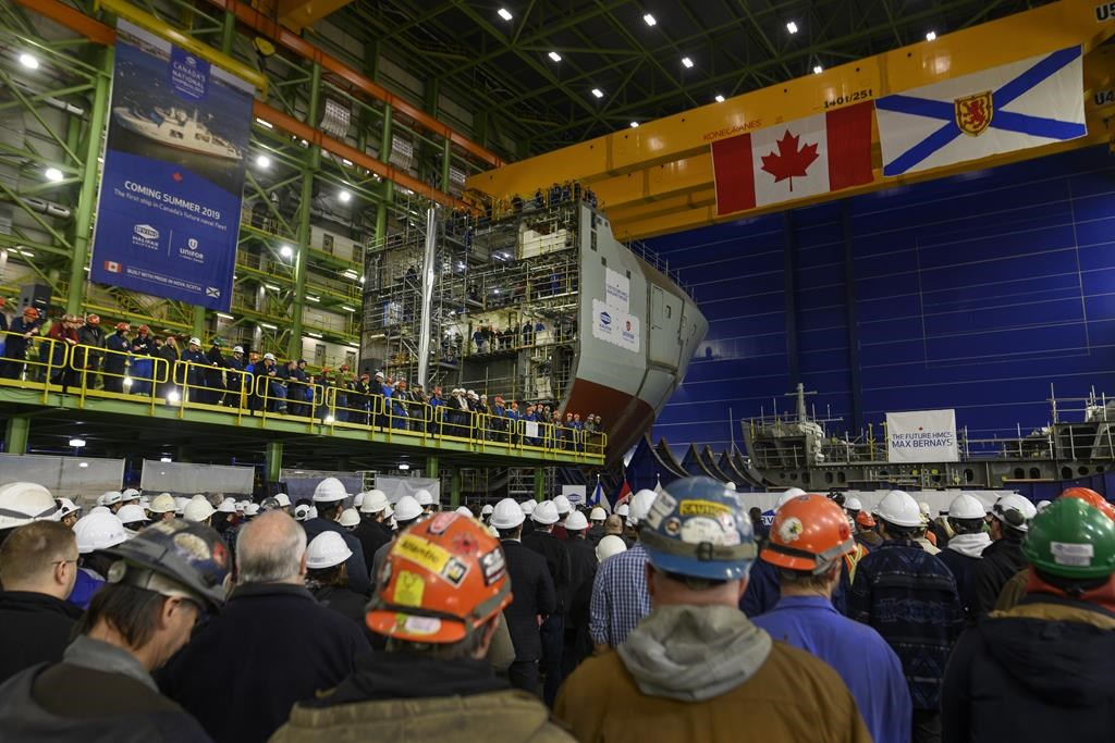 Shipbuilders and Irving employees attend the announcement of Lockheed Martin Canada as the designer of 15 new Canadian Surface Combatants to be built at Irving Shipbuilding's Halifax shipyard in Halifax on Friday, February 8, 2019. THE CANADIAN PRESS/Darren Calabrese.