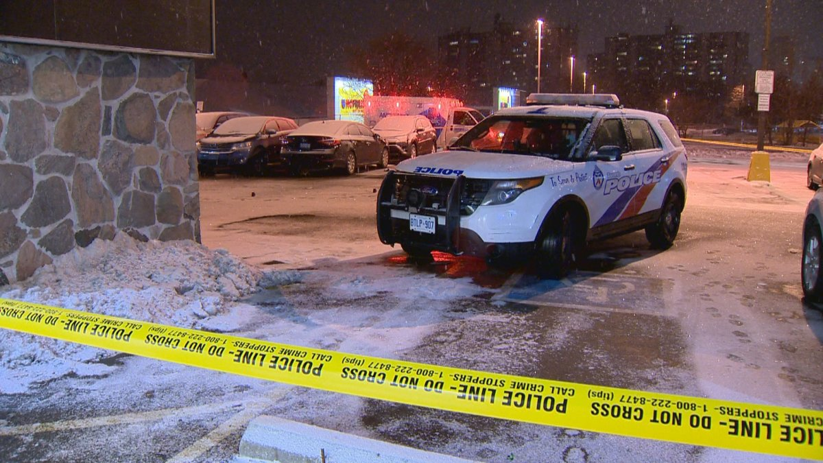 Police investigate a shooting at a plaza in Etobicoke on Feb. 10, 2019.