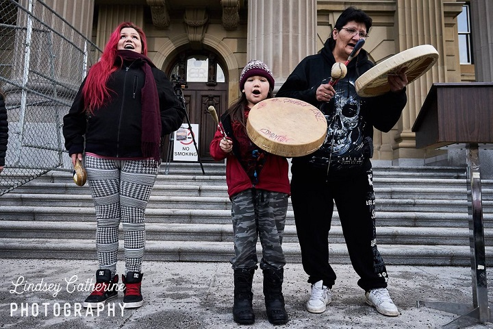 Chubby Cree performs at the Edmonton Women's Anniversary March in January 2018.